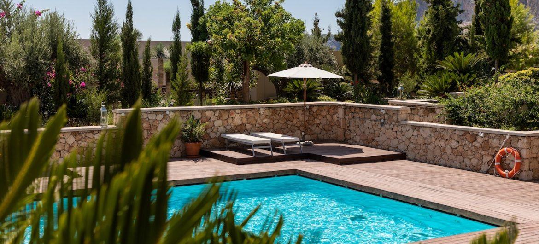 backyard pool with trees